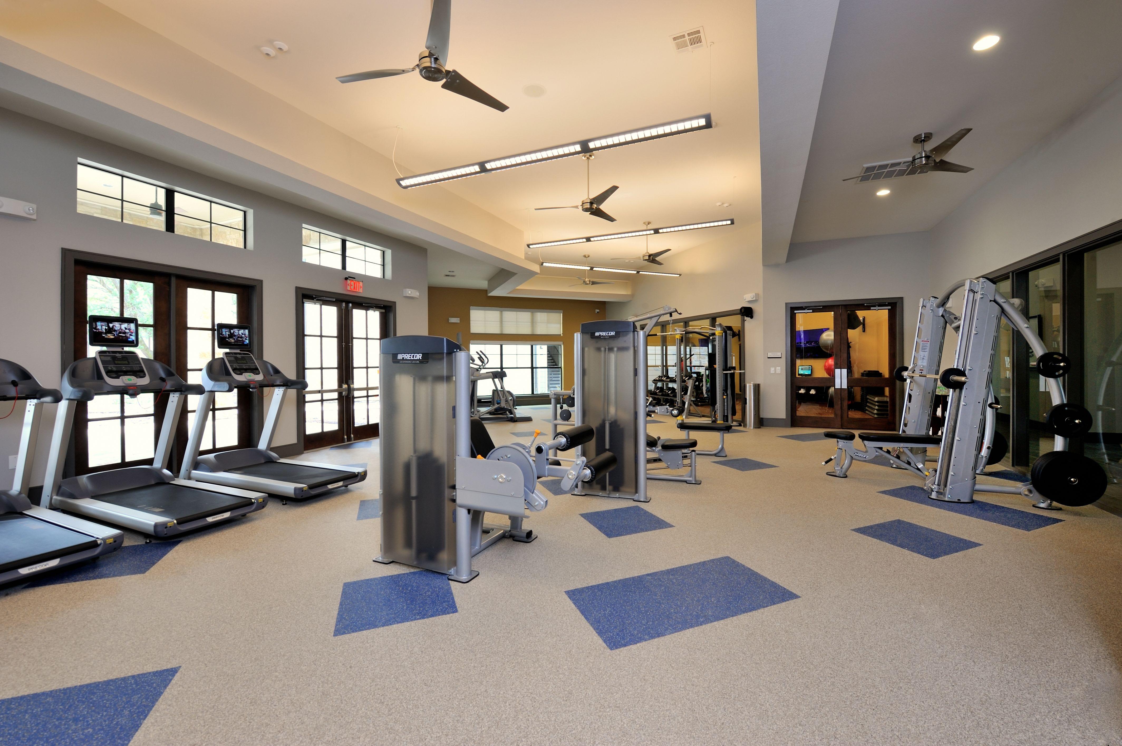 Fitness room at Olympus Falcon Landing in Katy, TX