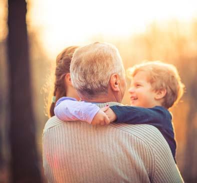 Senior hugging family at HOLI Senior Living in Hillsboro, OR