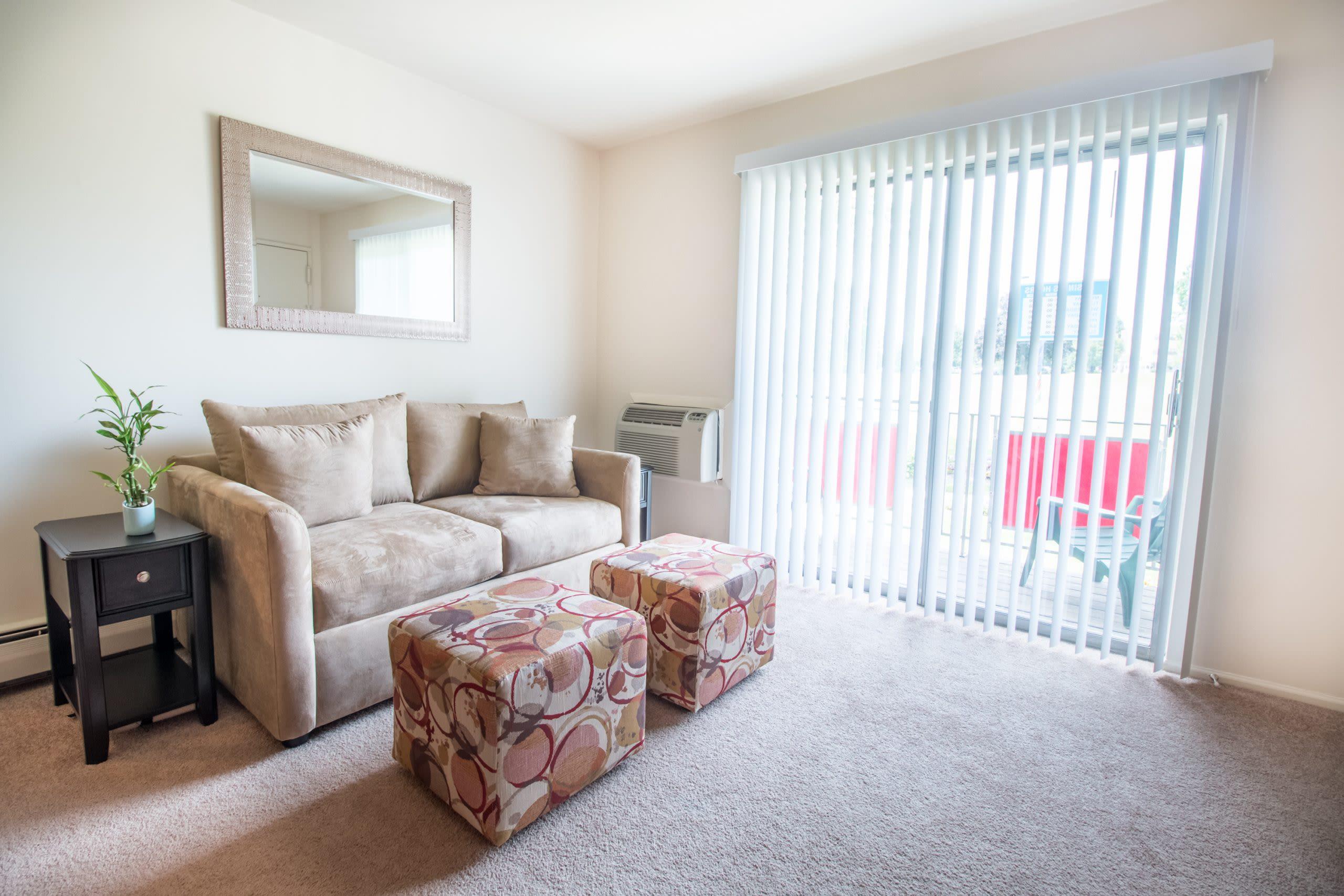Model living room with patio at Brakeley Gardens in Phillipsburg, New Jersey