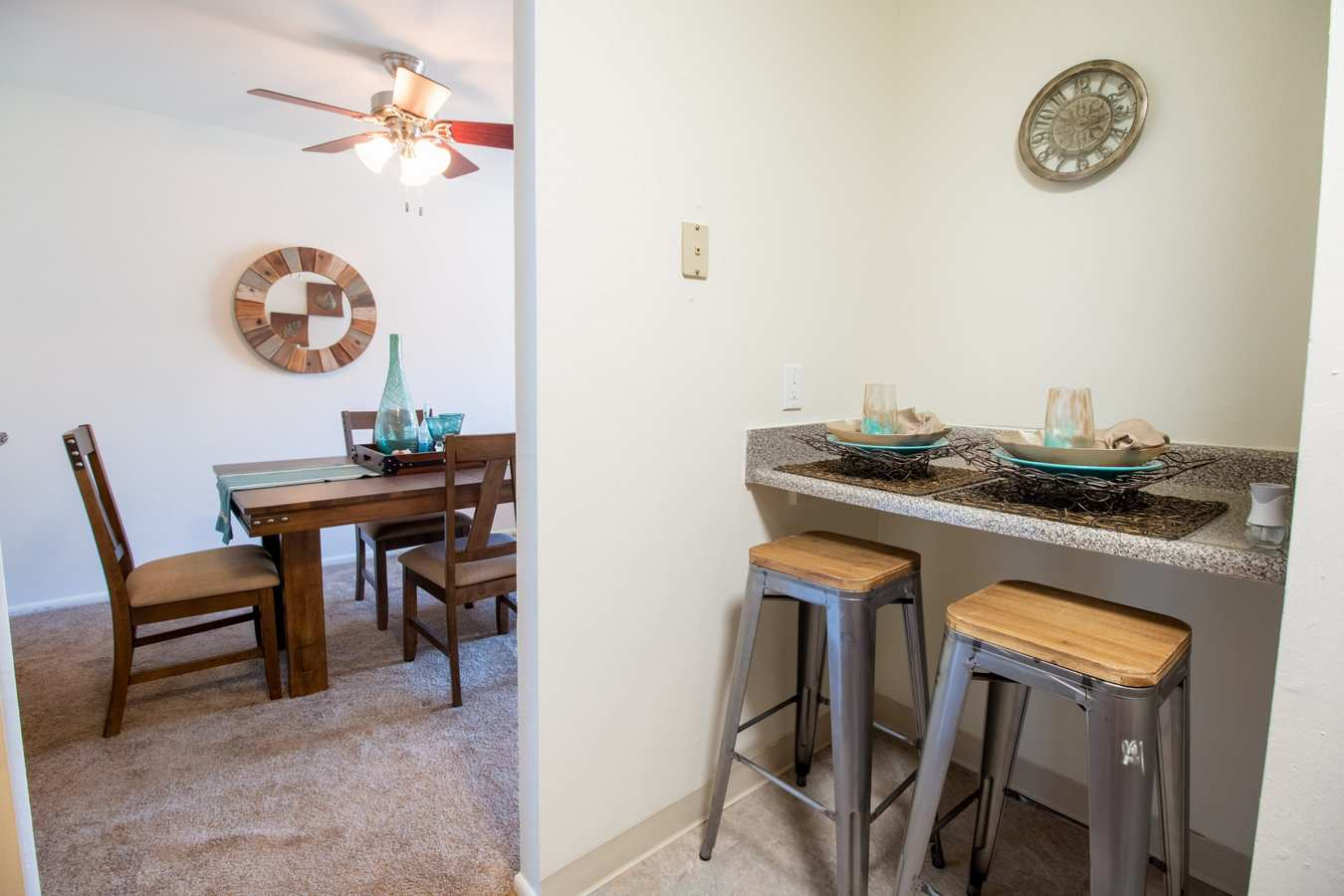 Model dining area with breakfast bar at Mill Village in Millville, New Jersey