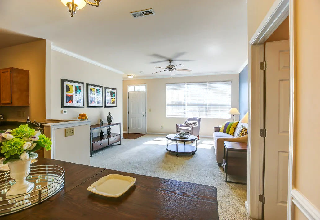 The living room, viewed from the kitchen, at an apartment at Charleston Pines Apartment Homes in Florence, Kentucky