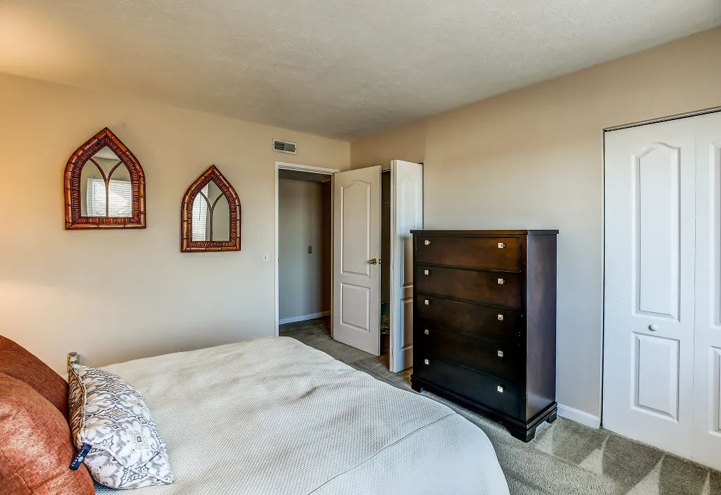A furnished bedroom at Reserve at Ft. Mitchell Apartments in Ft. Mitchell, Kentucky