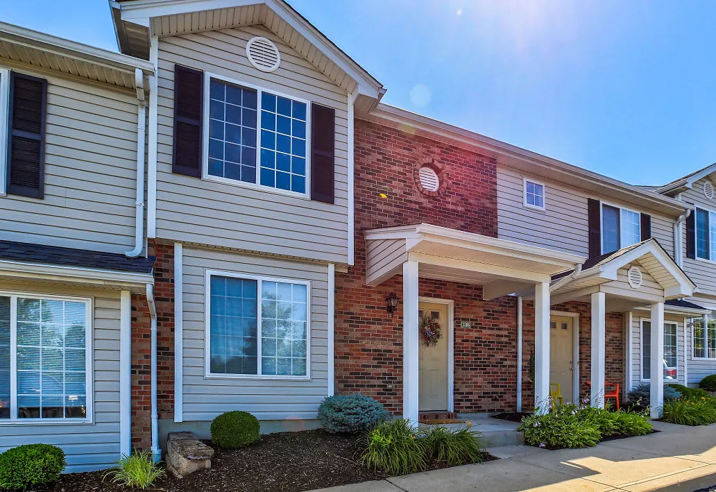 Brick and wood townhome exterior at Reserve at Ft. Mitchell Apartments in Ft. Mitchell, Kentucky