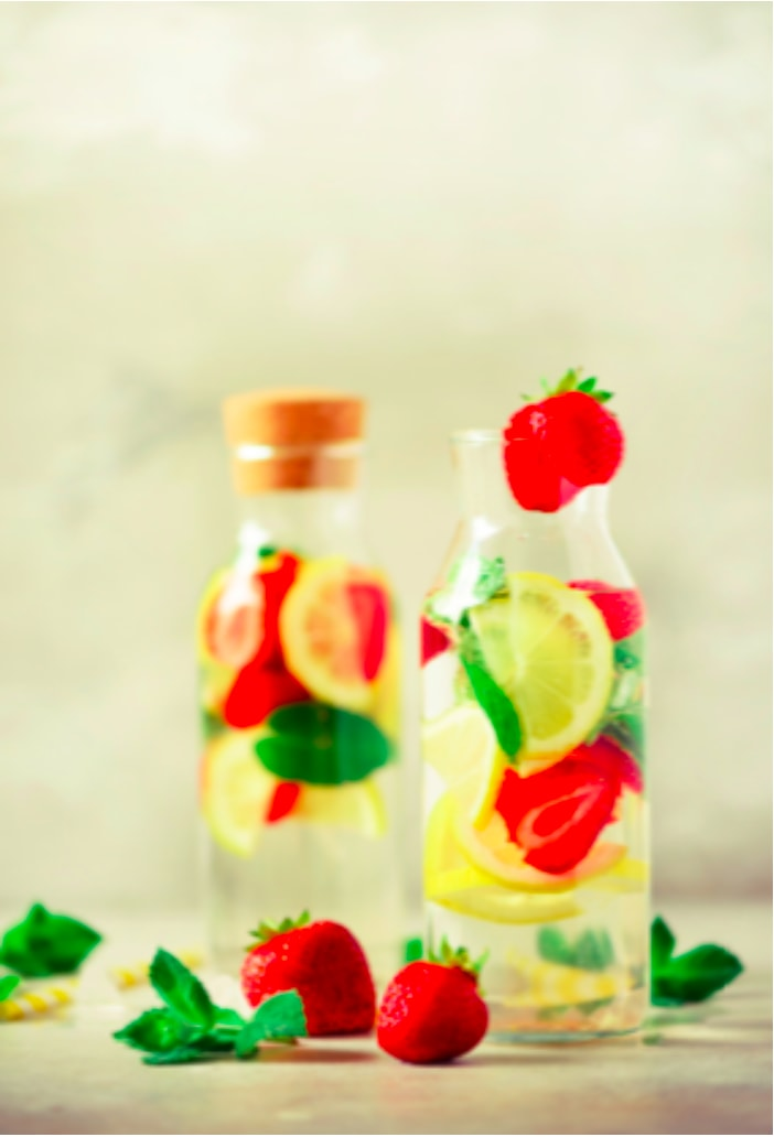 Water infused with lemon and strawberry beverage