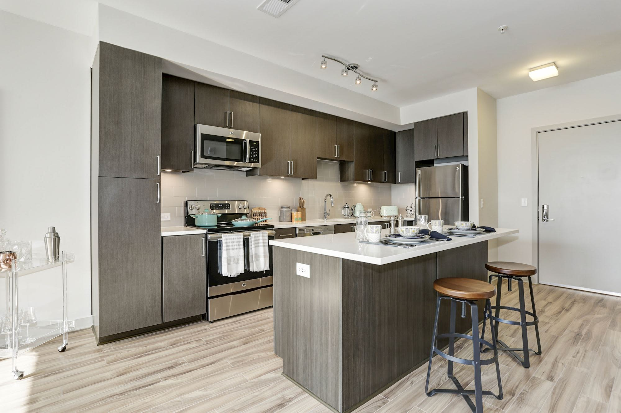 Model kitchen with chef's island at Metropolitan Rockville Town Center in Rockville, Maryland