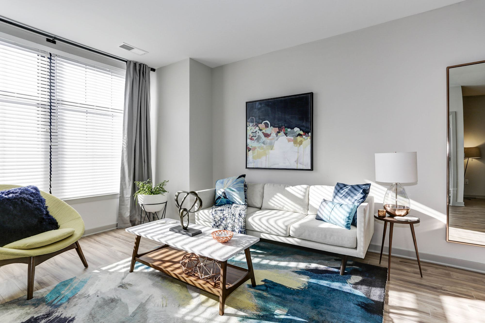 Model living room with lots of natural light at Metropolitan Rockville Town Center in Rockville, Maryland