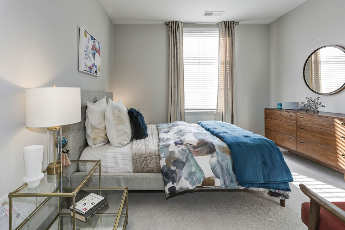 Well decorated bedroom at Metropolitan Rockville Town Center in Rockville, Maryland