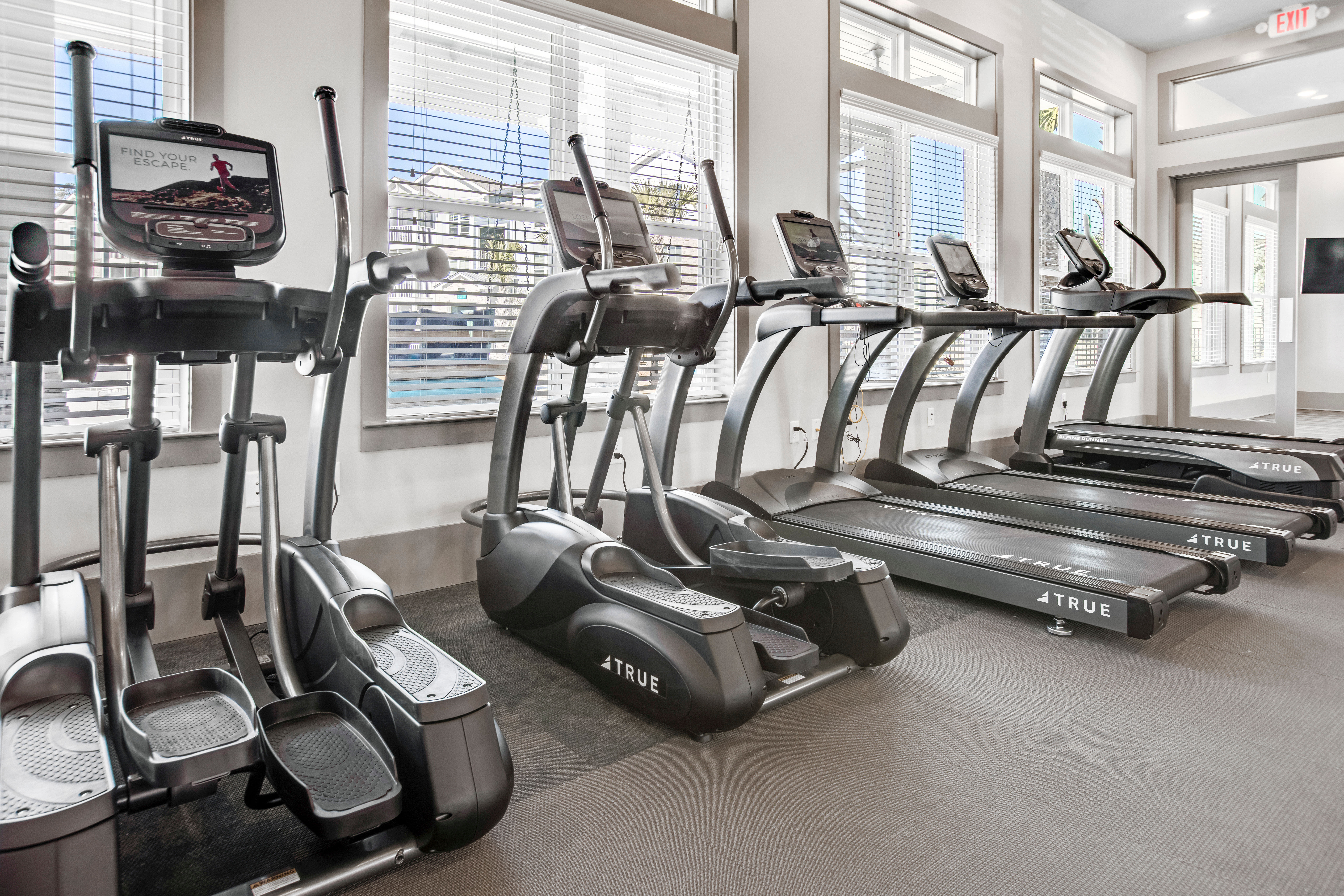 Full sized state of the art fitness center at South City Apartments in Summerville, South Carolina