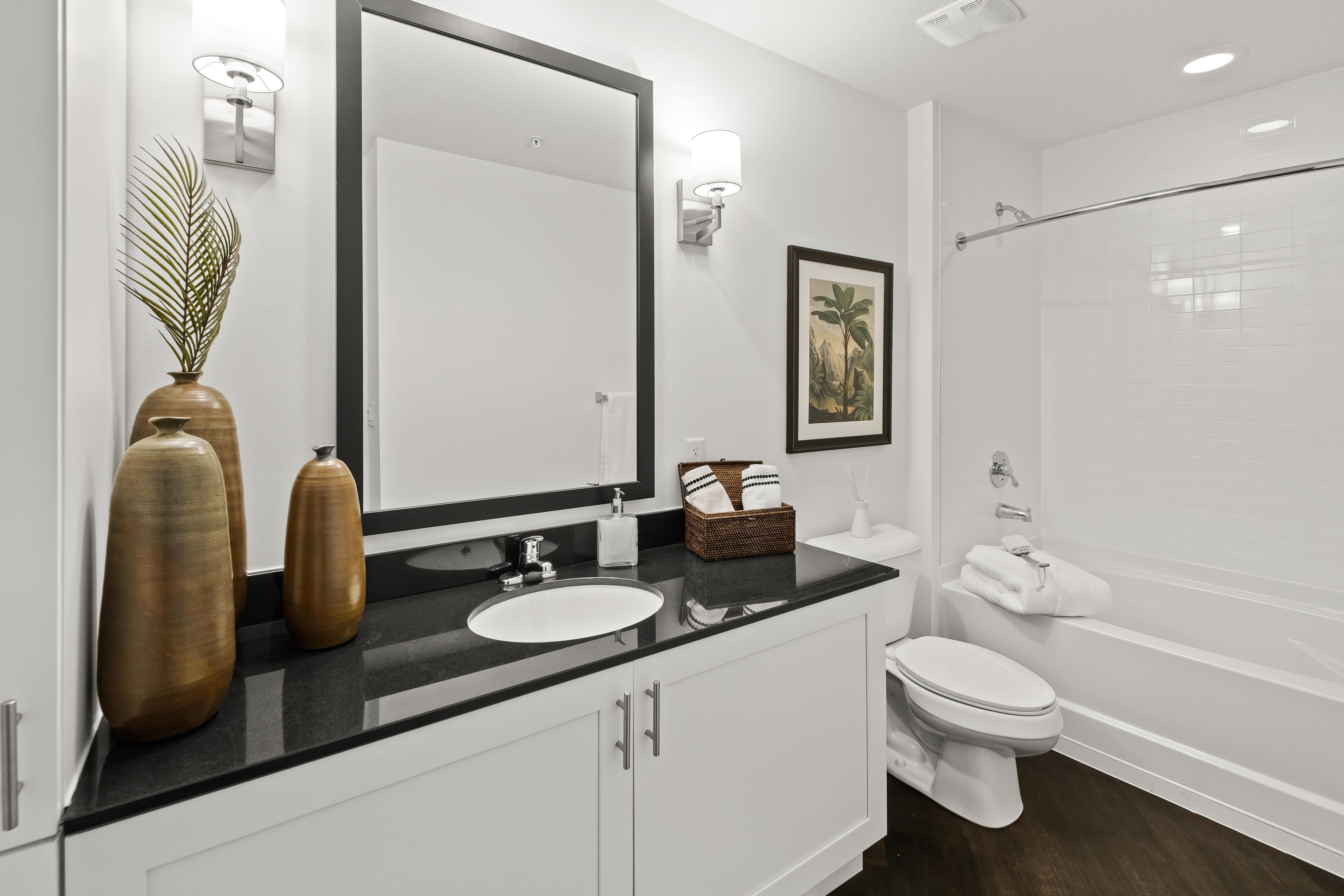 Well lit bathroom with oversize vanity at Town Lantana in Lantana, Florida