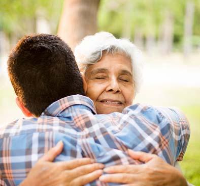 Seniors hugging at Heritage Heights in Chelan, Washington