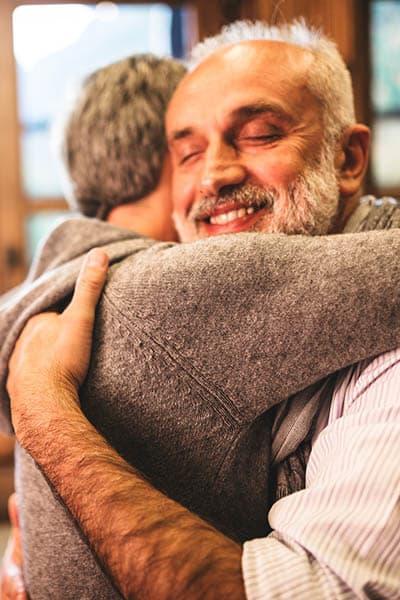 Seniors embracing at Heritage Heights in Chelan, Washington