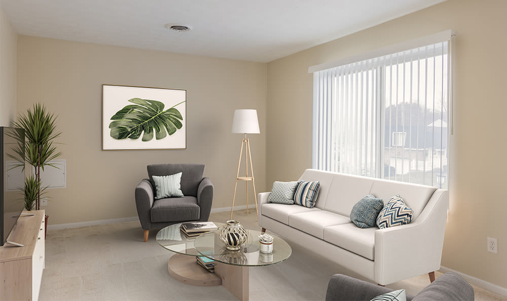 Naturally well-lit living room at Newcastle Apartments home in Rochester, New York