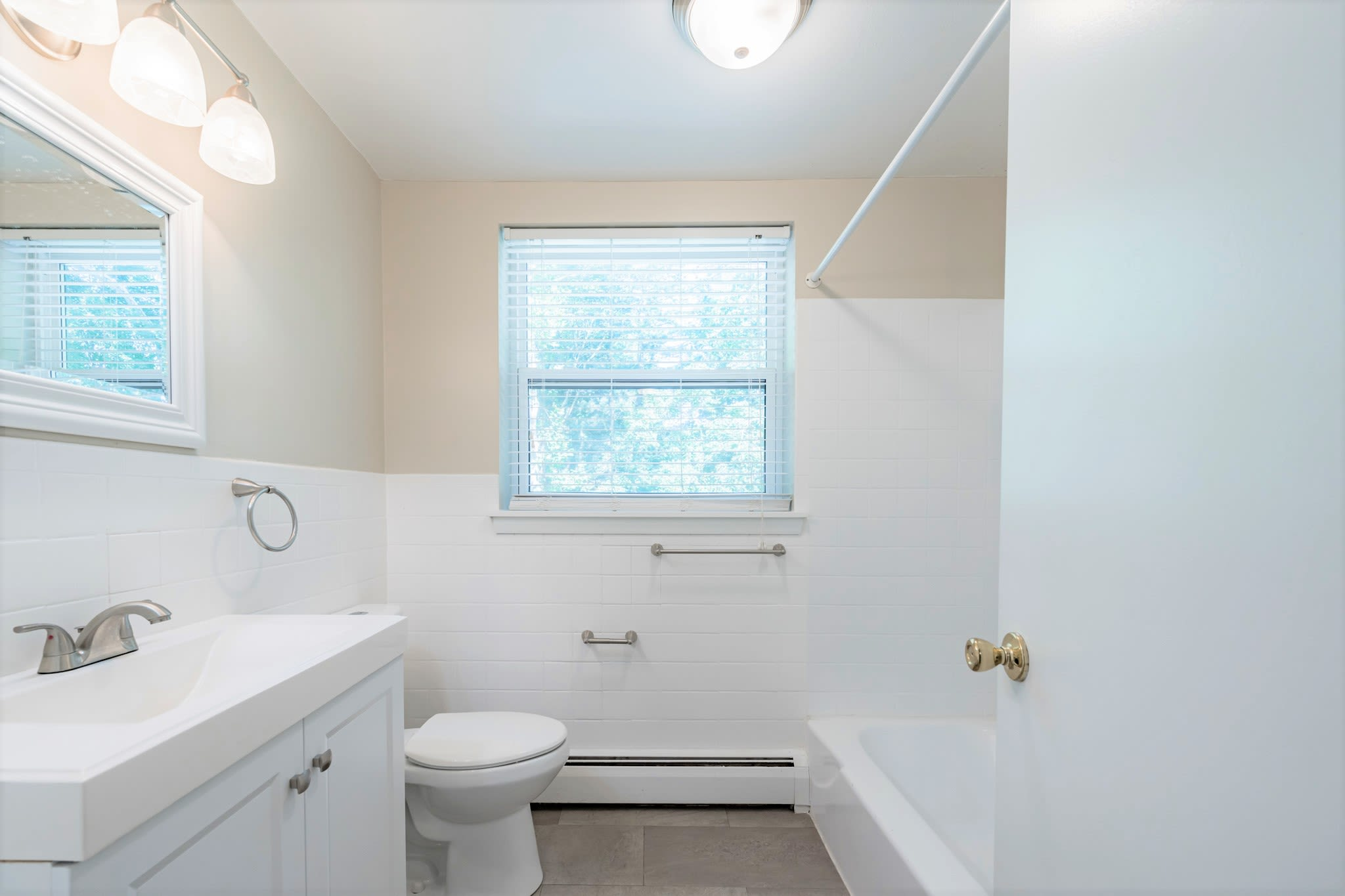 Bathroom with large window for lots of natural light at Eagle Rock Apartments at West Hartford in West Hartford, Connecticut