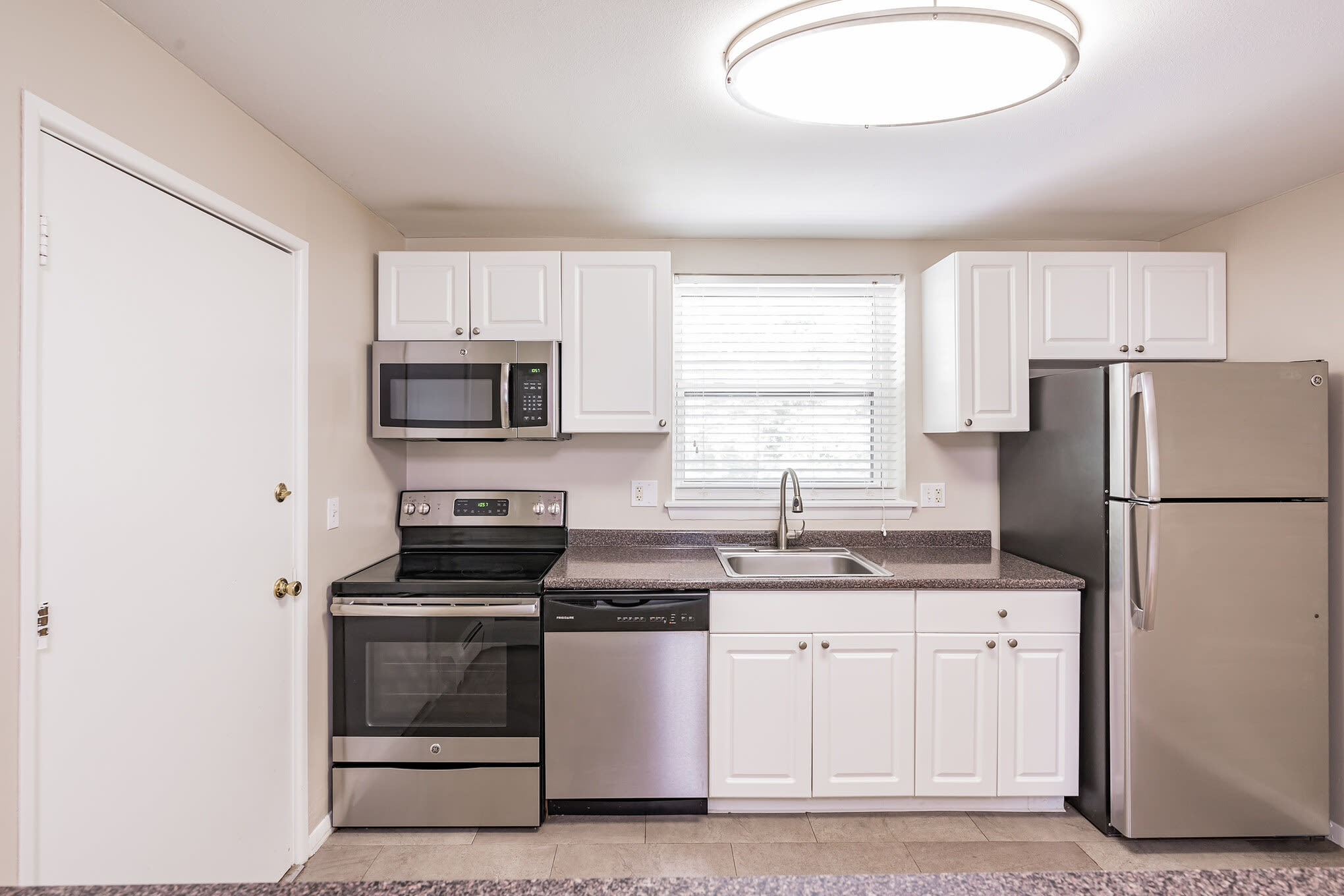 Kitchen with steel appliances at Eagle Rock Apartments at West Hartford in West Hartford, Connecticut