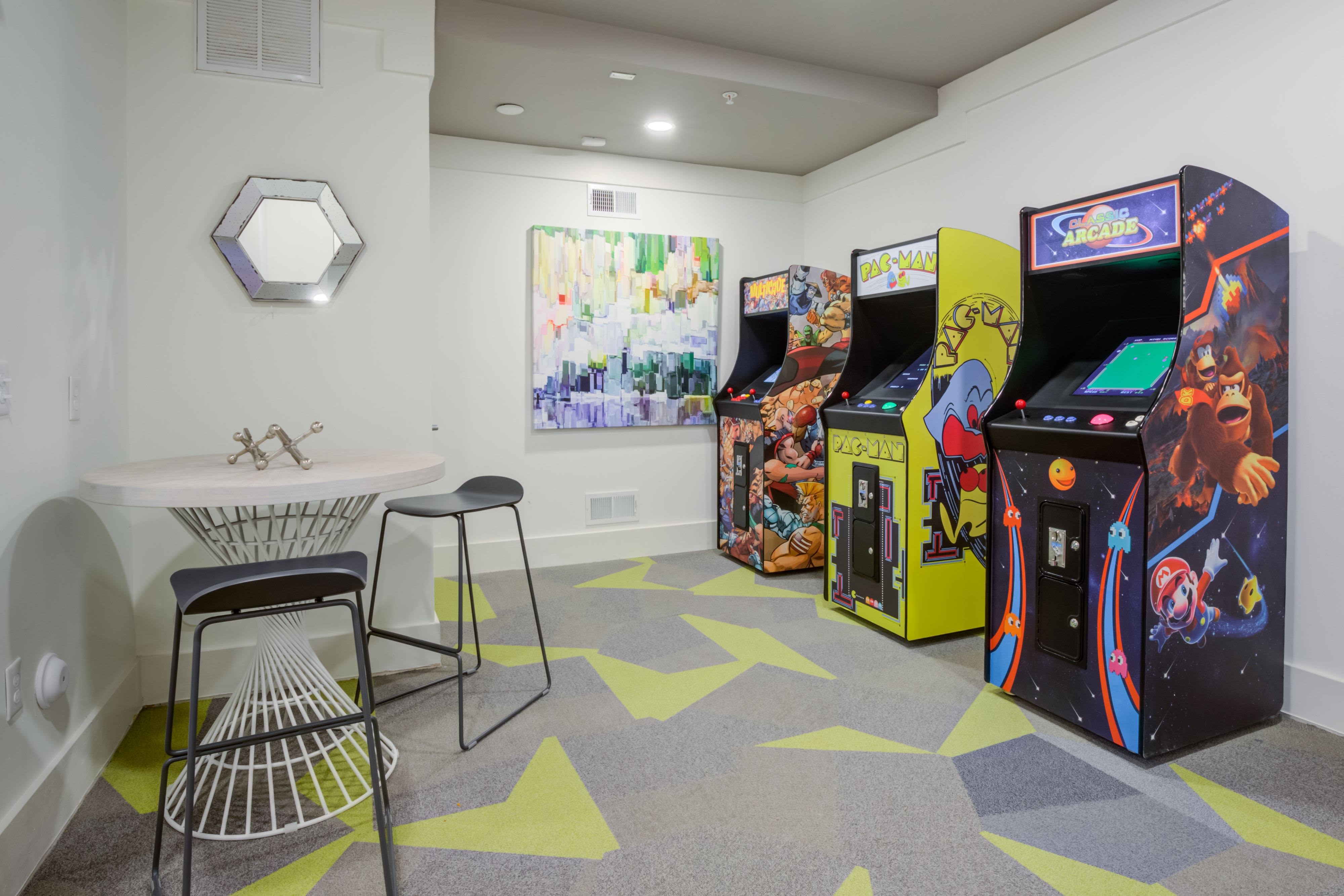 Game room with arcade games at Celsius Apartment Homes in Charlotte, North Carolina