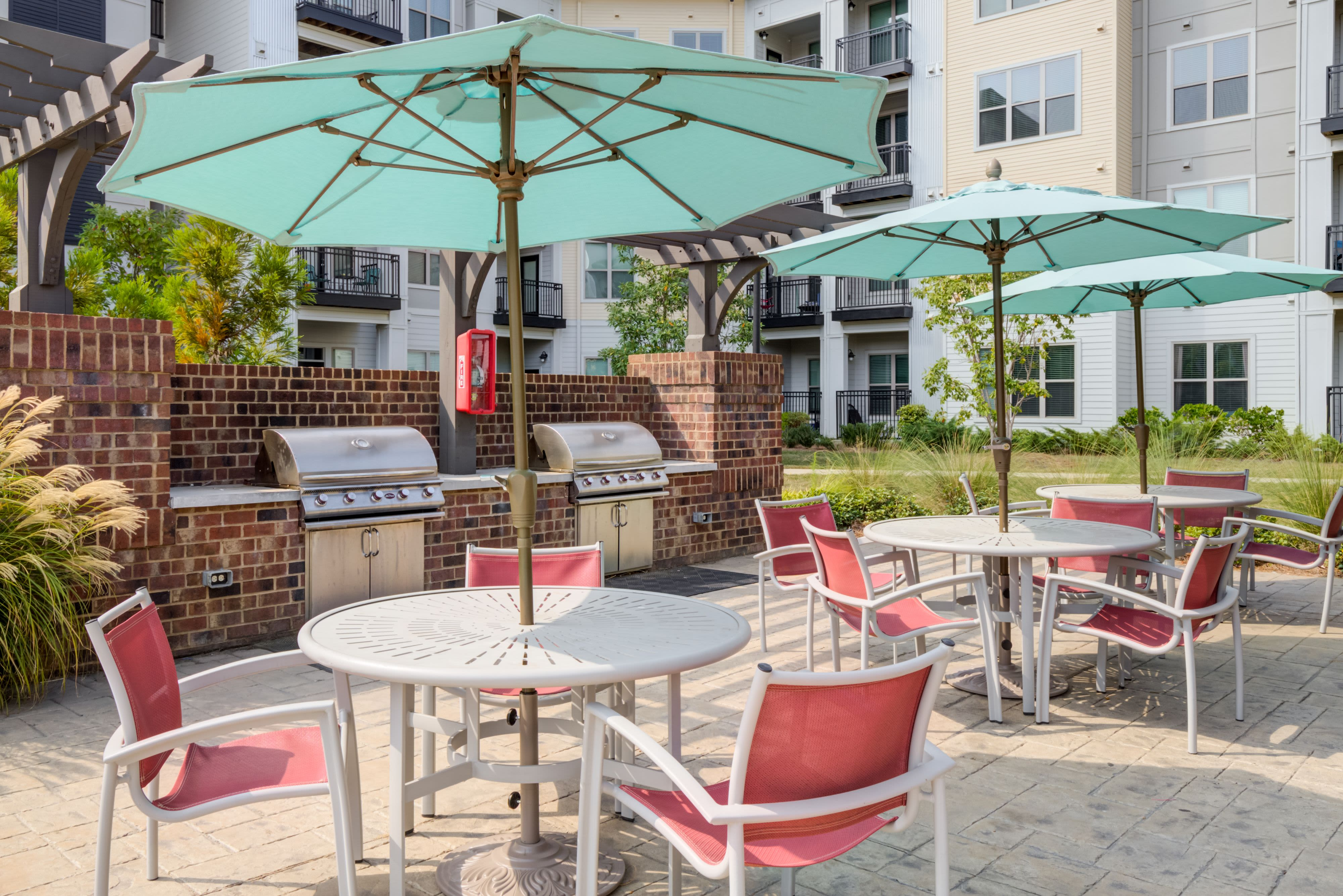 Poolside shaded seating at Celsius Apartment Homes in Charlotte, North Carolina