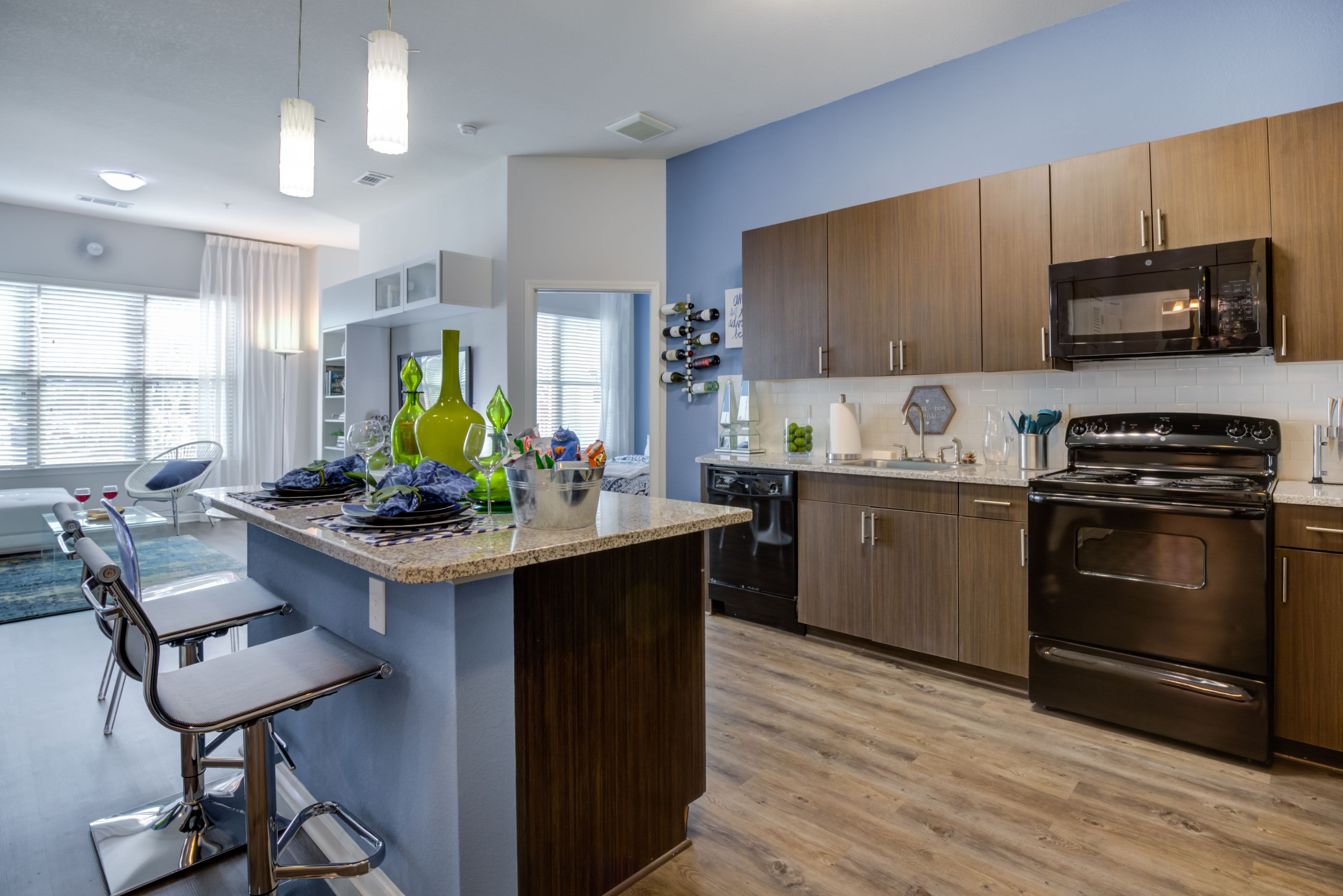 Kitchen with chef's island at Celsius Apartment Homes in Charlotte, North Carolina