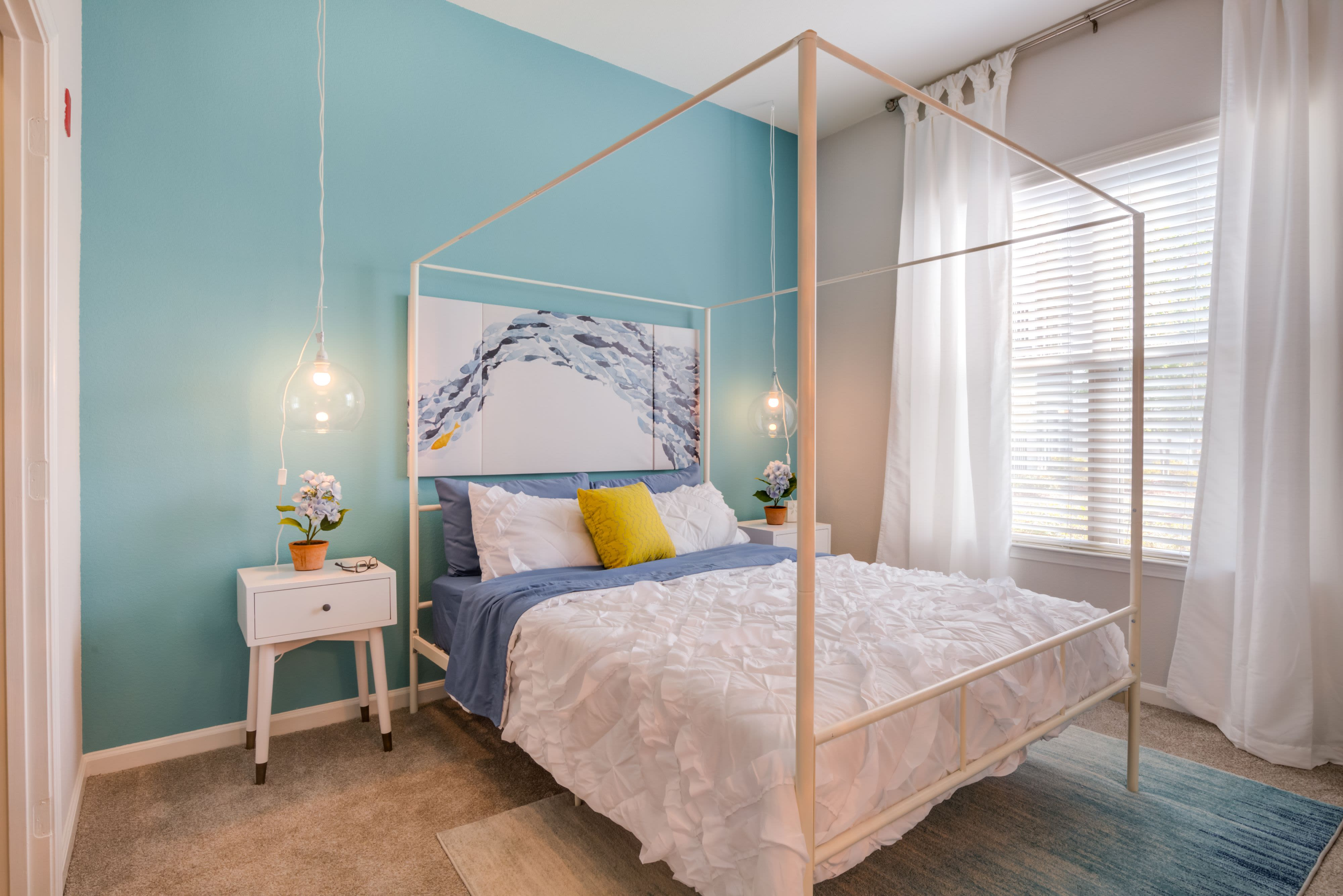 Model bedroom at Celsius Apartment Homes in Charlotte, North Carolina