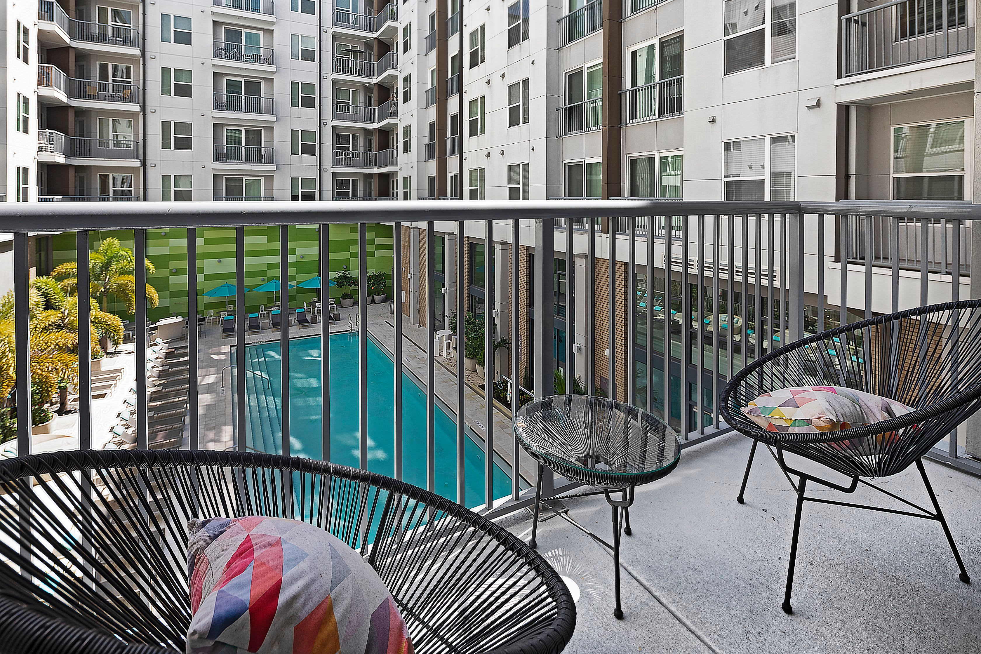 Porch in an apartment overlooking the pool at Central Station on Orange in Orlando, Florida