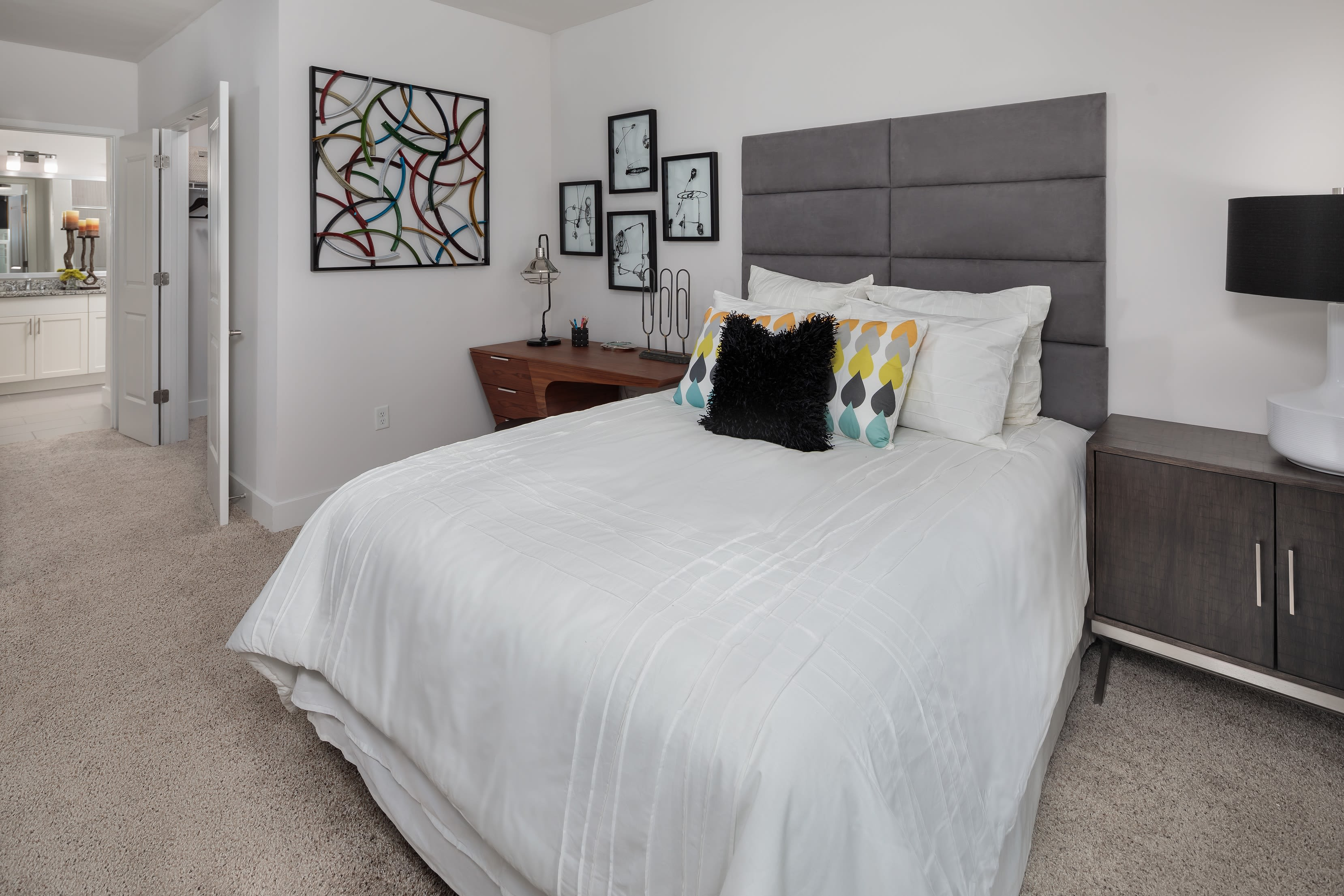 Decorated bedroom with large windows and carpeted floors at Central Station on Orange in Orlando, Florida
