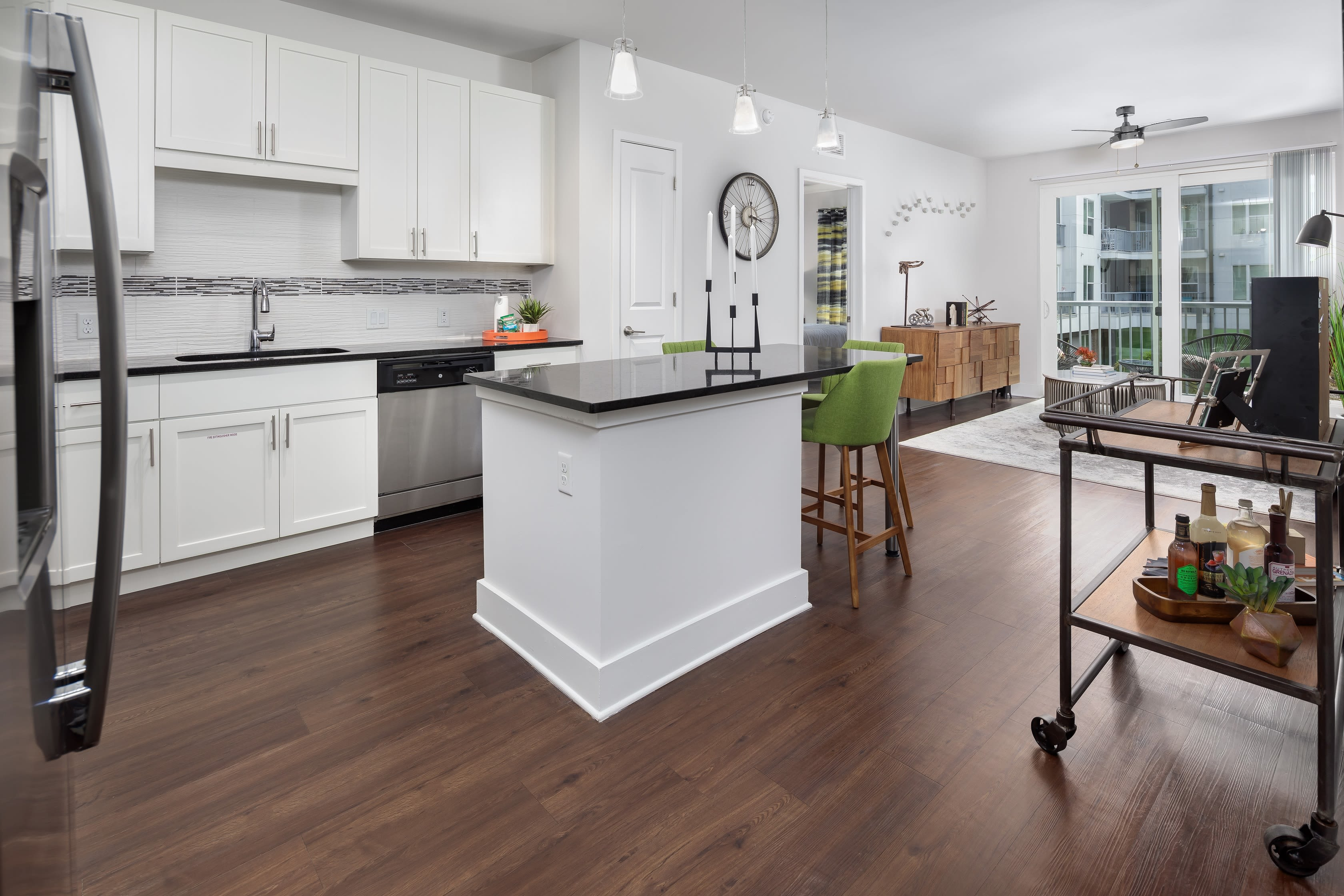 Kitchen with stainless steel appliances and granite style countertops at Central Station on Orange in Orlando, Florida