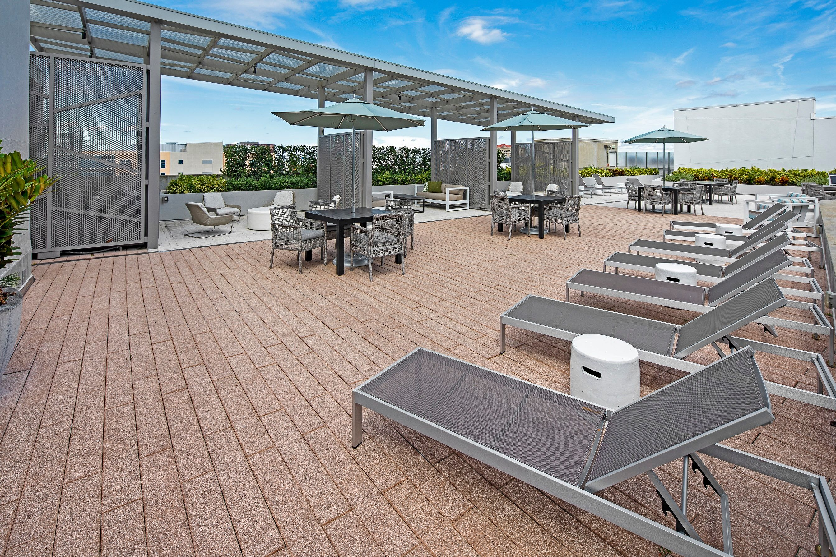 Rooftop lounge area with tons of comfy chairs for everyone to sit in at Central Station on Orange in Orlando, Florida