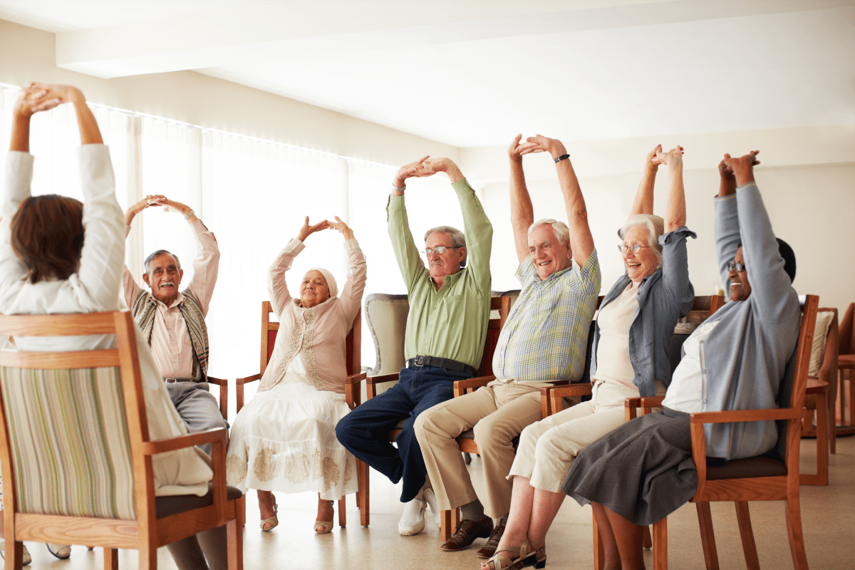 Residents participating in a fitness class at Northglenn Heights Assisted Living in Northglenn, Colorado