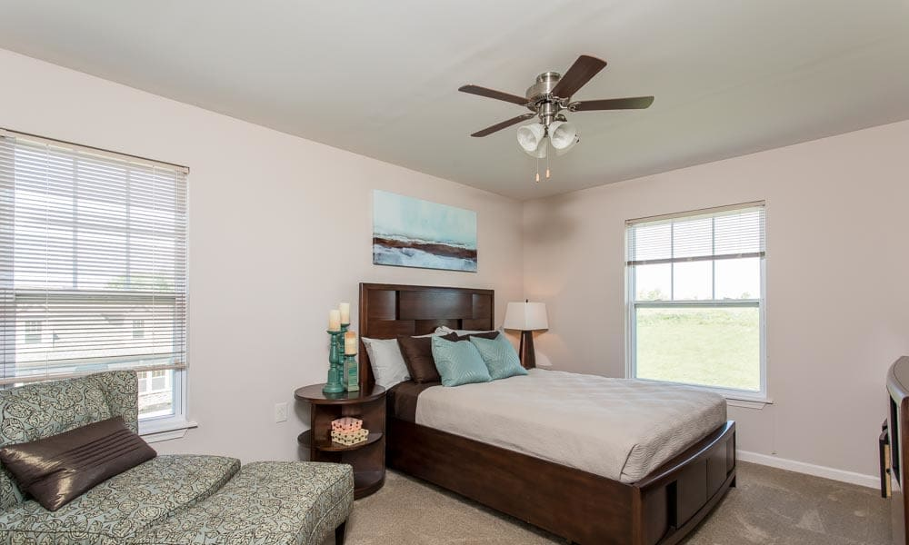 Bedroom with a ceiling fan at Preserve at Autumn Ridge in Watertown, New York