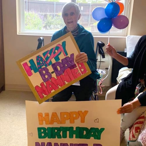 Resident celebrating a birthday at Oxford Glen Memory Care at Sachse in Sachse, Texas
