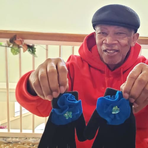 Resident holding up a pair of winter gloves at FountainBrook in Midwest City, Oklahoma