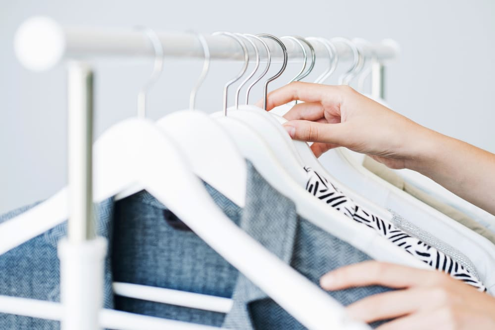 Packing shirts for storage at Devon Self Storage in Thousand Palms, California
