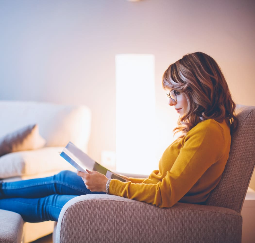 Woman reading a book at Eagle Point Apartments in Tulsa, Oklahoma
