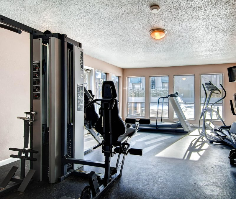 Residents fitness center with cardio and weight machines at Arvada Village Apartment Homes in Arvada, Colorado