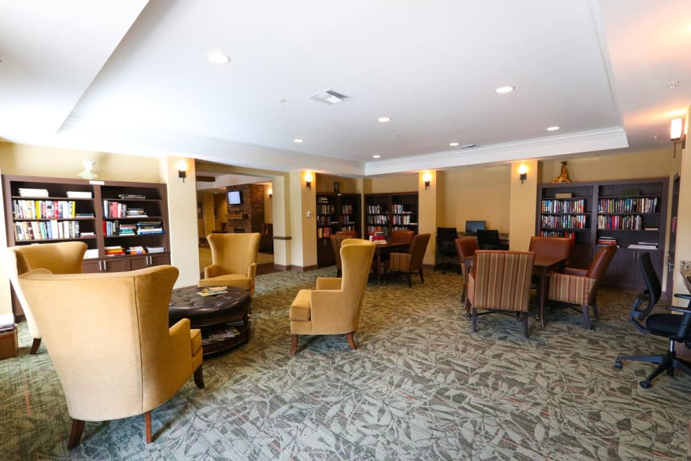 A library with cozy seating at Harmony at Reynolds Mountain in Asheville, North Carolina