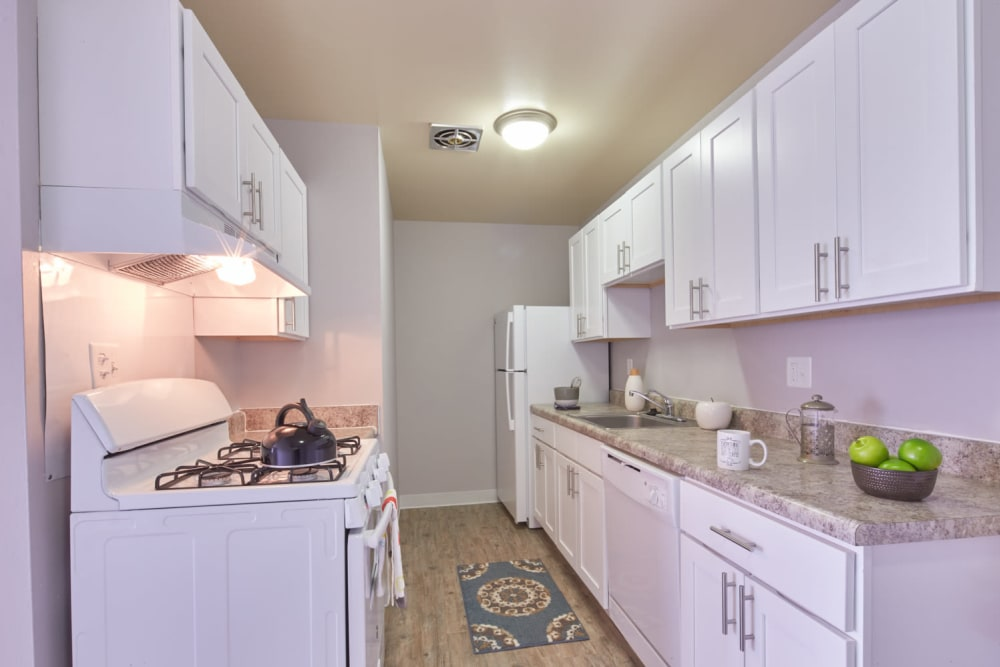 Galley style kitchen at President Madison Apartments in Madison Heights, Michigan