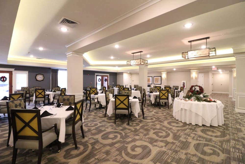 Well decorated dining room tables at Harmony at Five Forks in Simpsonville, South Carolina