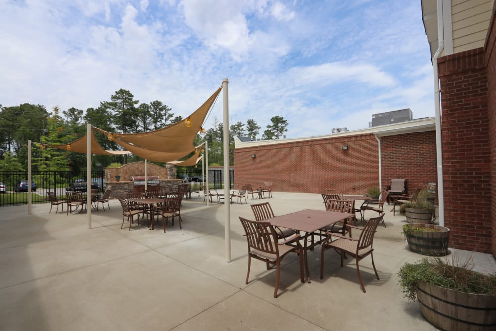 Covered outdoor seating at The Harmony Collection at Columbia - Independent Living in Columbia, South Carolina