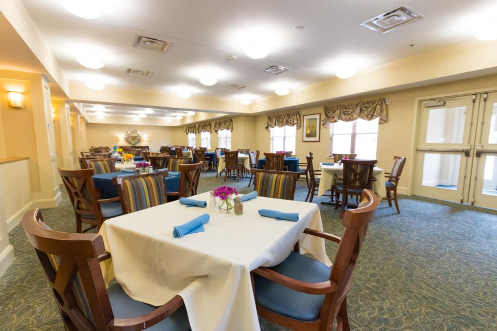 Well decorated dining room tables at The Harmony Collection at Columbia - Independent Living in Columbia, South Carolina