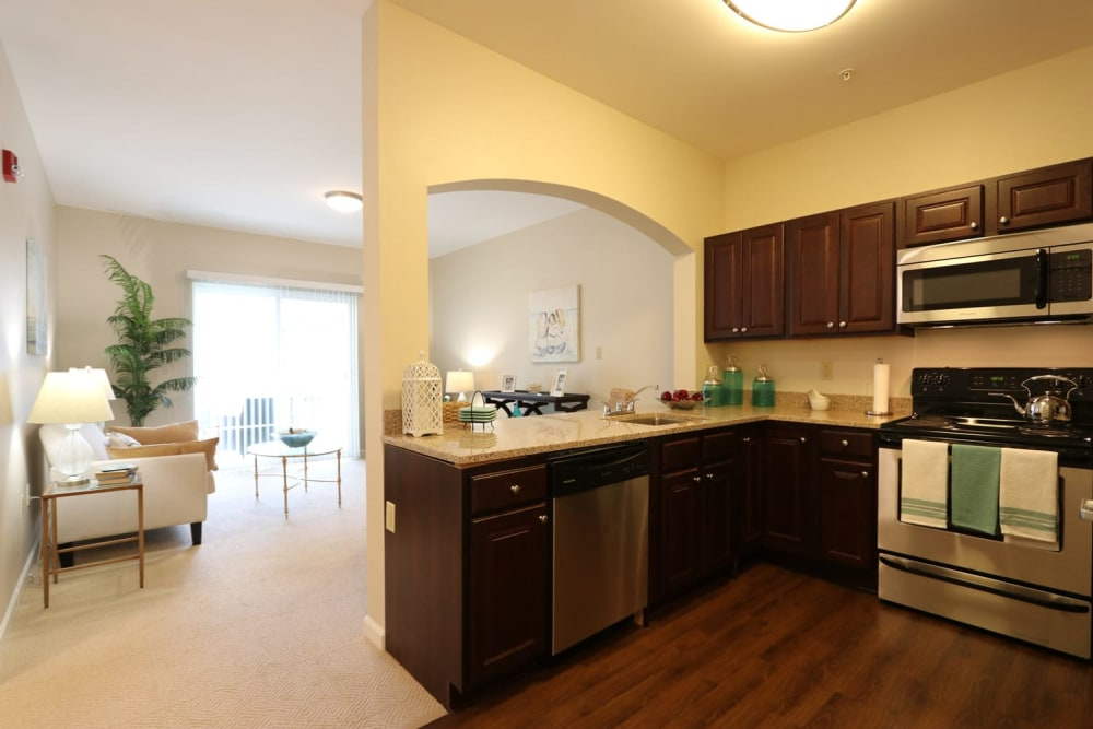 An apartment kitchen and living room at Harmony at Independence in Virginia Beach, Virginia