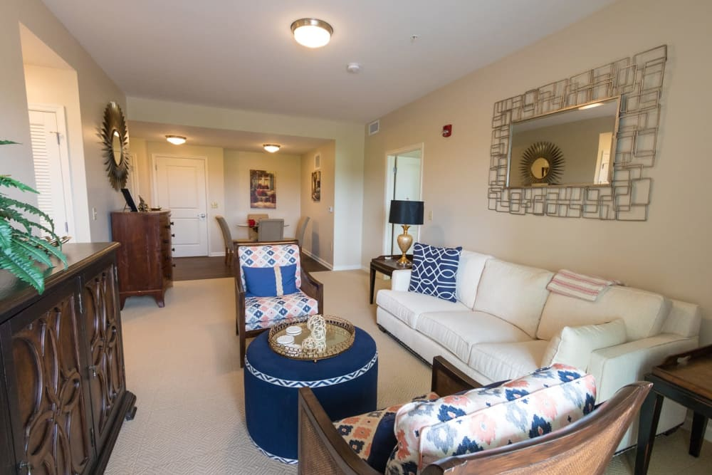 An apartment living room and dining room at Harmony at Independence in Virginia Beach, Virginia