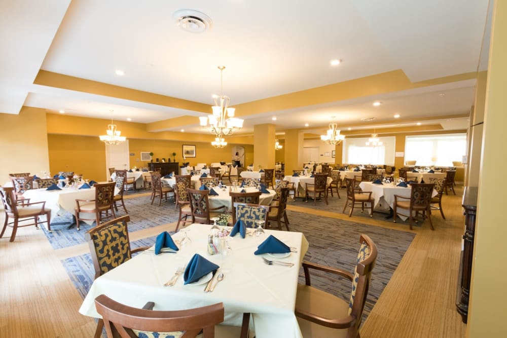 Well decorated dining room tables at Harmony at Independence in Virginia Beach, Virginia