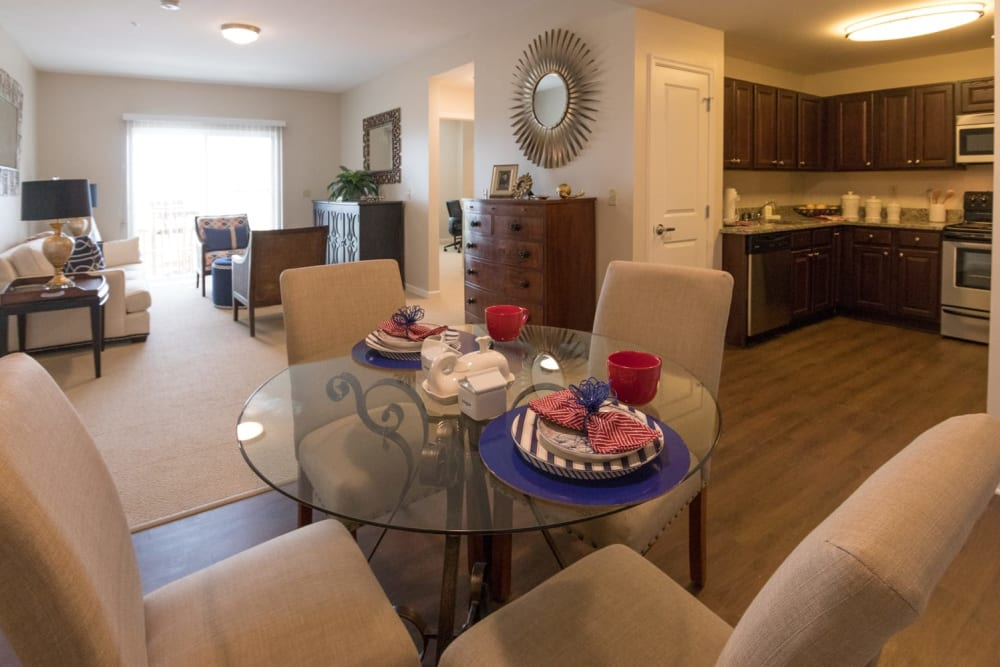 A decorated dining room table in an apartment at Harmony at Independence in Virginia Beach, Virginia