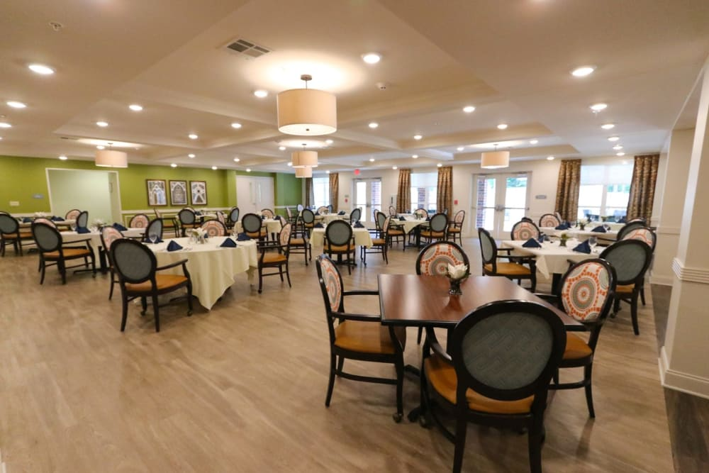 Set dining room tables at Harmony on the Peninsula in Yorktown, Virginia