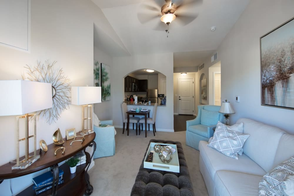 A furnished apartment living room at Harmony at Wescott Plantation in Summerville, South Carolina