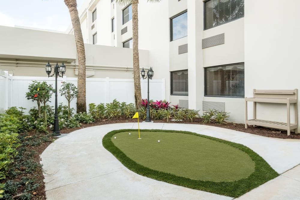 Putting green at Grand Villa of Boynton Beach in Florida