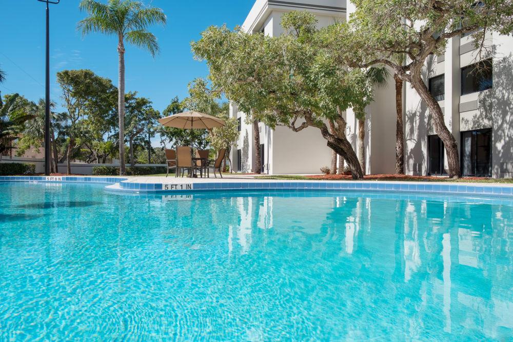 Sparkling swimming pool at Grand Villa of Boynton Beach in Florida