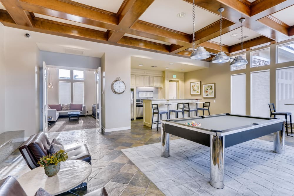 Modern clubhouse with a billiards table at Alize at Aliso Viejo Apartment Homes in Aliso Viejo, California