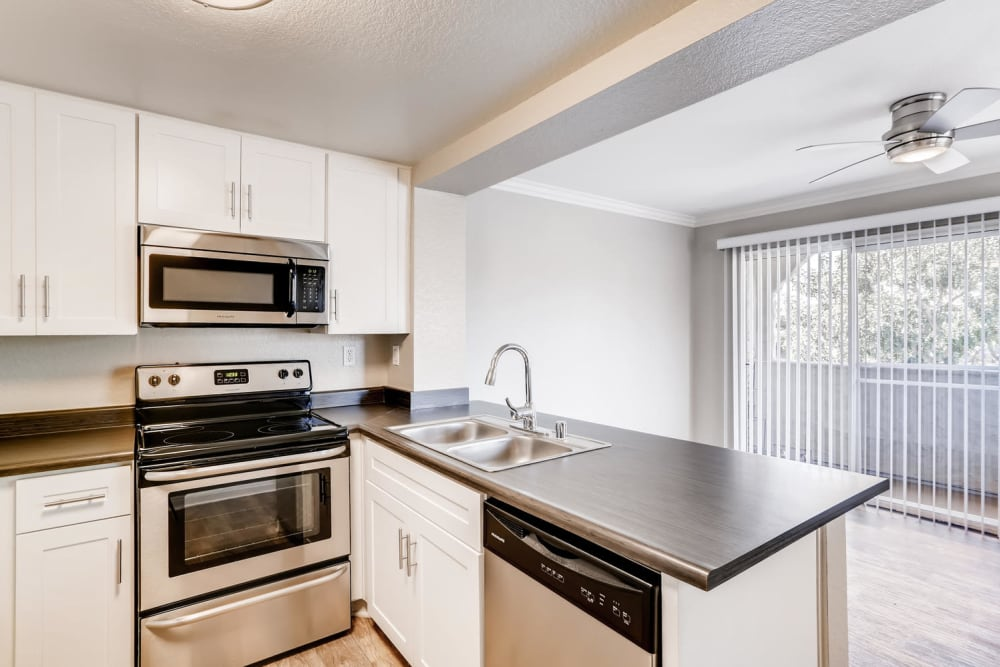 Kitchen with wood-style flooring at Hidden Hills Condominium Rentals in Laguna Niguel, California