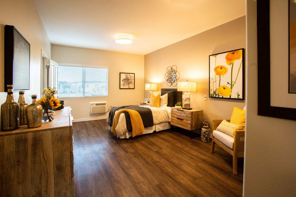 Resident bedroom with hardwood floors at Carefield Pleasanton in Pleasanton, California