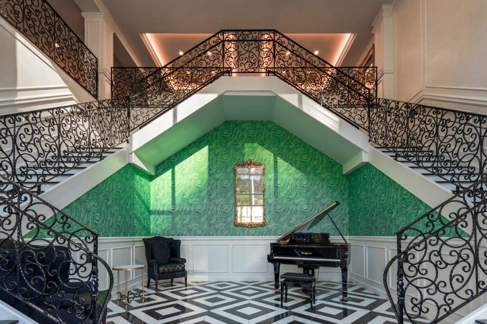 Grand piano at the base of staircases at The Royal Athena in Bala Cynwyd, Pennsylvania